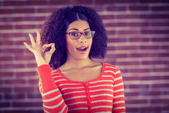 Attractive young woman showing OK sign Royalty Free Stock Images