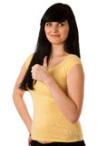 Attractive young woman showing ok sign with thumb up Stock Photography