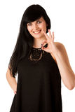Attractive young woman showing ok sign with thumb up Stock Image