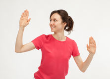 Attractive young woman showing palms Royalty Free Stock Photography
