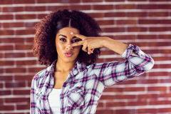 Attractive young woman showing peace sign Stock Photo