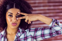 Attractive young woman showing peace sign Stock Photography