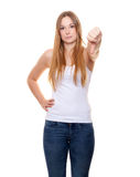 Attractive young woman showing thumbs down Royalty Free Stock Image