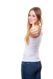 Attractive young woman showing thumbs up Royalty Free Stock Photography