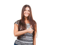 Attractive young woman shows thumb up sign Royalty Free Stock Images