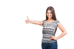Attractive young woman shows thumb up sign Royalty Free Stock Photography