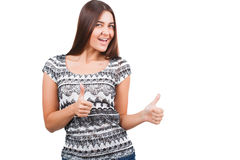 Attractive young woman shows thumb up sign Stock Image