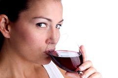 Attractive young woman sipping wine Royalty Free Stock Photo