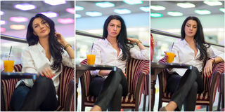 Attractive young woman sitting on armchair in shopping center. Beautiful fashionable young lady wearing white male shirt in mall. Royalty Free Stock Image