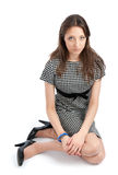 Attractive young woman sitting on a floor Royalty Free Stock Photos
