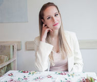 Attractive young woman sitting in the restaurant. Royalty Free Stock Photography