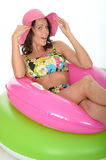 Attractive Young Woman Sitting in Rubber Rings Wearing a Swimsuit Stock Photos