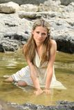 Attractive young woman sitting in the water Stock Photo