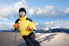 Attractive young woman skiing Royalty Free Stock Images