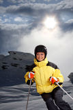 Attractive young woman skiing Stock Photo