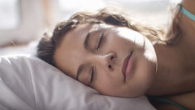 Attractive young woman sleeping in bed Stock Image