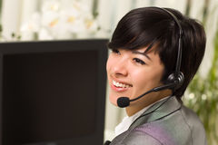 Attractive Young Woman Smiles Wearing Headset Royalty Free Stock Photos