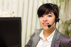 Attractive Young Woman Smiles Wearing Headset Royalty Free Stock Images