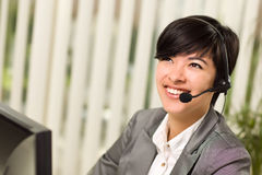 Attractive Young Woman Smiles Wearing Headset Stock Photo