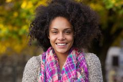 Attractive young woman smiling in autumn  outdoors Royalty Free Stock Photography