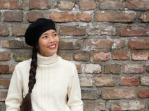 Attractive young woman smiling with beret hat Royalty Free Stock Photography