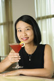 Attractive Young Woman Smiling with Beverage Stock Images