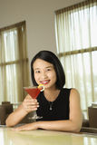 Attractive Young Woman Smiling with Beverage Royalty Free Stock Photos