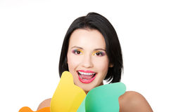 Attractive young woman smiling with colorful makeup and windmill Stock Images