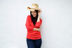 Attractive young woman smiling with cowboy hat. Portrait of an attractive young woman smiling with cowboy hat Royalty Free Stock Image