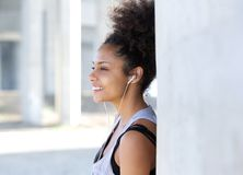 Attractive young woman smiling with earphones Stock Photo