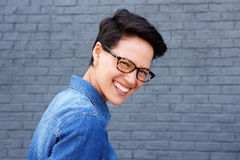 Attractive young woman smiling with glasses and short hair royalty free stock photos