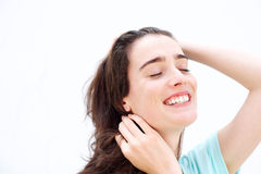 Attractive young woman smiling  with hands in hair Royalty Free Stock Image