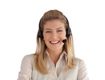 Attractive young woman smiling with headset on Royalty Free Stock Photography