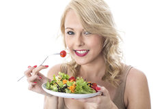 Attractive Young Woman Smiling Holding Plate of Colourful Salad Royalty Free Stock Images