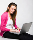 Attractive young woman smiling with laptop Stock Images