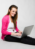 Attractive young woman smiling with laptop Royalty Free Stock Image