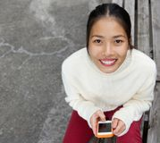 Attractive young woman smiling with mobile phone Stock Photography