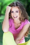 Attractive young woman smiling Stock Photo