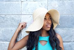 Attractive young woman smiling with sun hat. Close up portrait of an attractive young woman smiling with sun hat Royalty Free Stock Photo