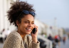 Attractive young woman smiling and talking on mobile phone Stock Image