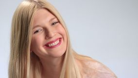 Attractive young woman smiling to the camera stock footage