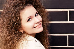 Attractive young woman smiling on the wall background Royalty Free Stock Photos