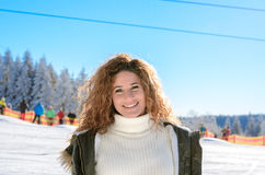 Attractive young woman in a snowy winter landscape Royalty Free Stock Images