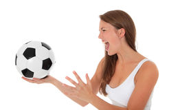 Attractive young woman with soccer ball Royalty Free Stock Photos