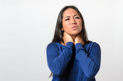 Attractive young woman with a sore throat Stock Photography