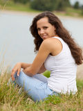 Attractive young woman spends time outside Stock Photography