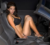 Attractive young woman in sports car Stock Photos