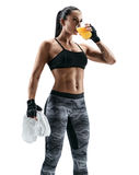Attractive young woman in sports wear holding towel and drink juice. royalty free stock image
