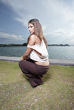 Attractive young woman squatting Stock Image