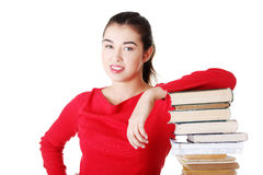 Attractive young woman with stack of books. Stock Photos